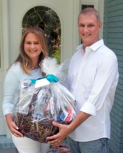 Couple holding a basket life gift