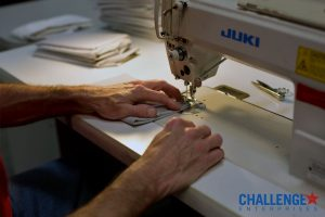 Image of someone using a sewing machine