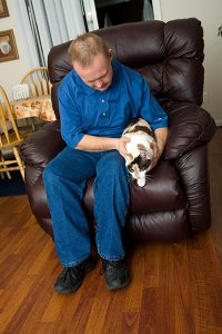 Adult with Different Abilities sitting with his cat