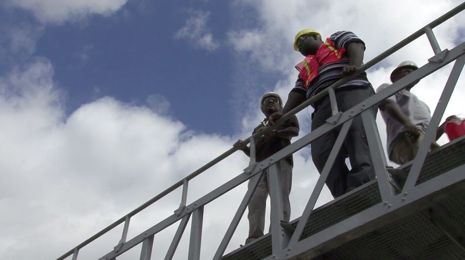 Workers standing on a vantage point looking out